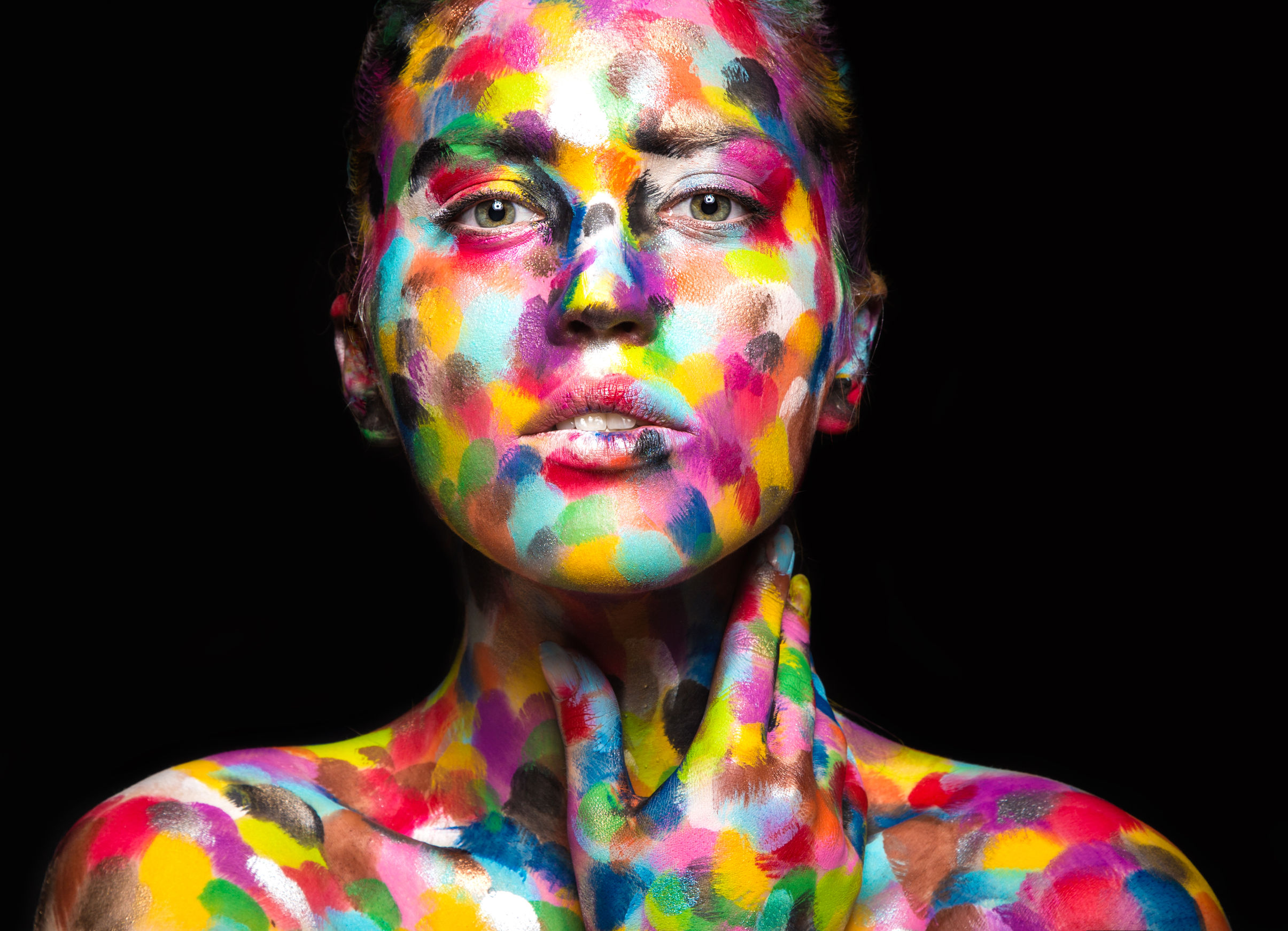43728650 - girl with colored face painted. art beauty image. picture taken in the studio on a black background.